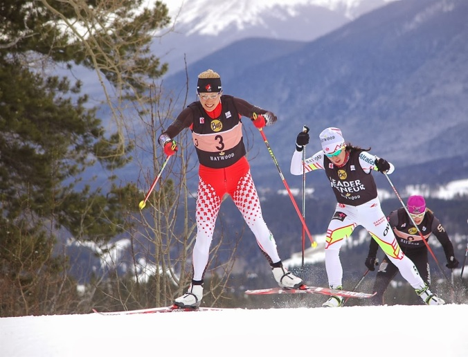 Biathlete Zina Kocher put in a great effort in front of The Pride of Yukon, Emily Nishikawa.